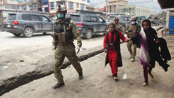 Security personnel escorting those trapped inside the gurdwara attacked by IS gunmen in Kabul, Afghanistan   Twitter   @TOLOnews
