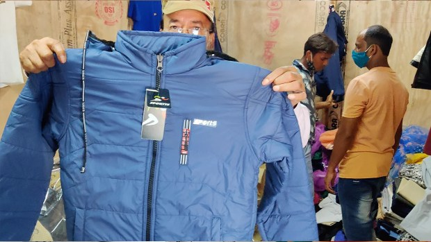 Wakeel Ahmed, one of the entrepreneurs at the zone, shows a jacket manufactured by his unit | Sajid Ali | ThePrint