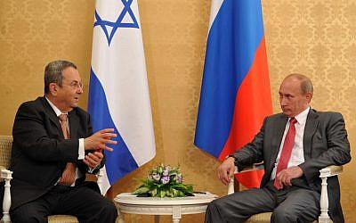 File photo of Ehud Barak, left, meeting with then-Russian prime minister Vladimir Putin. (photo credit: Ariel Hermoni/Flash90)