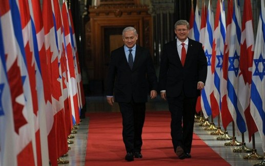 Prime Minister Benjamin Netanyahu with former Canadian Prime Minister Stephen Harper (right) in Ottawa, Canada, March 2, 2012 (photo credit: Amos Ben Gershom/GPO/Flash90)
