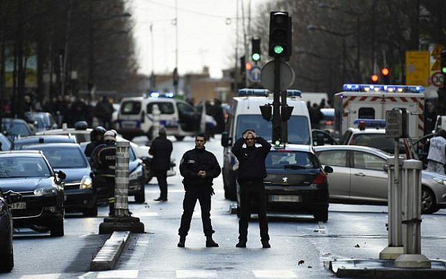 french police officers on patrol at the boulevard de barbes in the north of paris on