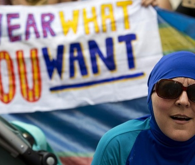 A Woman Wearing A Burkini Joins A Demonstration Outside The French Embassy In London On August