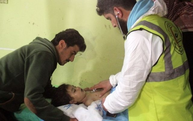 An unconscious Syrian child receives treatment at a hospital in Khan Sheikhun, a rebel-held town in the northwestern Syrian Idlib province, following a suspected toxic gas attack on April 4, 2017. (AFP Photo/Omar Haj Kadour)
