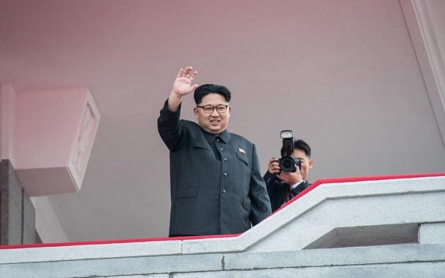 """(FILES) This file photo taken on May 10, 2016 shows North Korean leader Kim Jong-Un waving from a balcony of the Grand People's Study House to participants of a military parade and mass rally on Kim Il-Sung square in Pyongyang. North Korea launched an apparent missile into the Sea of Japan on August 29, 2017, South Korea's military said. The North fired the """"unidentified projectile"""" from Pyongyang at around 5:57 am (2057 GMT), according to the Joint Chiefs of Staff. / AFP PHOTO / Ed Jones"""