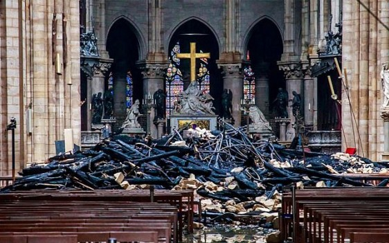 Debris inside the Notre Dame Cathedral in Paris on April 16, 2019, a day after a fire that devastated the iconic building. (Christophe Petit Tesson/Pool/AFP)