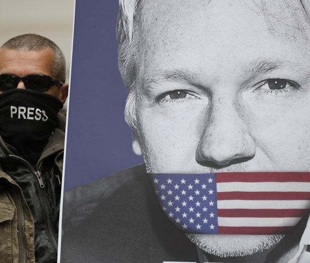 A Supporter Of Julian Assange With A Poster Of The Wikileaks Founder Joins Other