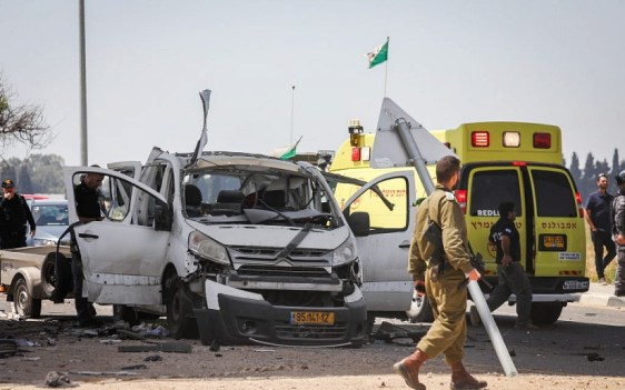 The scene of a car hit by a rocket fired from the Gaza Strip near the Israel-Gaza border on May 5, 2019. (Noam Rivkin Fenton/Flash90)