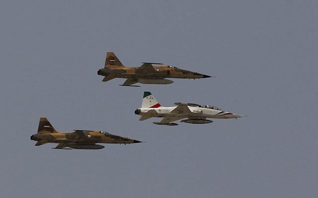 An illustrative photo of Iranian fighter jets flying over the mausoleum of late revolutionary founder Ayatollah Khomeini, during a military parade ceremony marking the anniversary of the start of the 1980-1988 Iraq-Iran war, just outside Tehran, Iran, September 22, 2009. (AP Photo/Vahid Salemi)