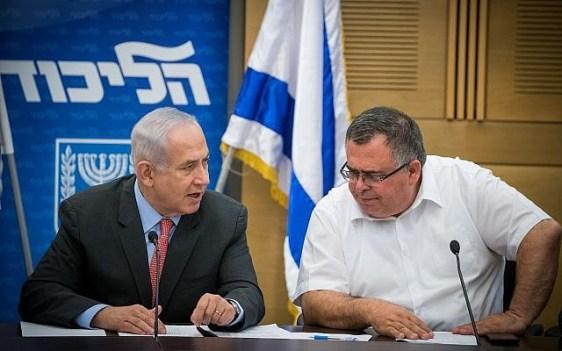 Prime Minister Benjamin Netanyahu and Likud MK David Bitan (R) at a Likud faction meeting at the Knesset on June 12, 2017. (Yonatan Sindel/Flash90)