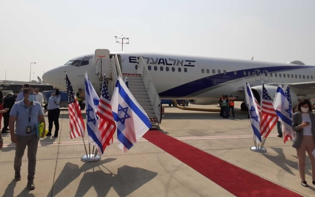 Israeli and US officials board the first commercial flight between Israel and the UAE, August 31, 2020 (Raphael Ahren/Times of Israel)