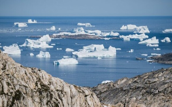In this file photo taken on August 15, 2019 an aerial photo taken on August 15, 2019 shows icebergs as they float along the eastern cost of Greenland near Kulusuk (Jonathan NACKSTRAND / AFP)