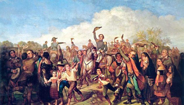 Dom Pedro, a cavalo e de uniforme militar, é festejado pela multidão de homens, mulheres e crianças