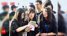 Testing time: South Korean students take exam with virus precautions – Times of India