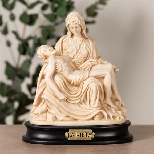 Ivory Pieta Statue on Black Stand