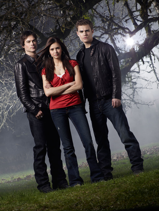 Two Vampires, A Girl, and a Graveyard Place.
