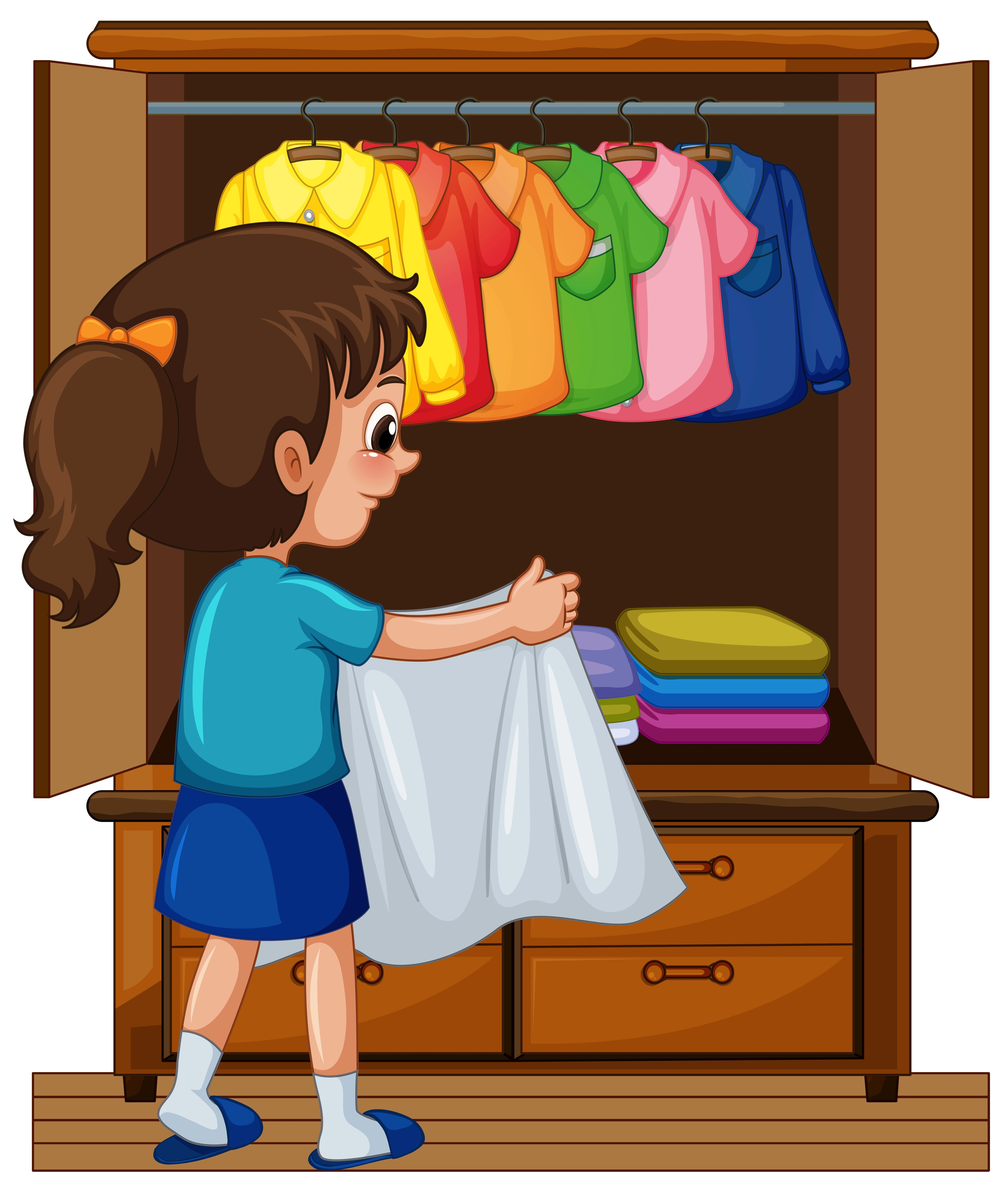 Girl Putting Away Clothes In Closet