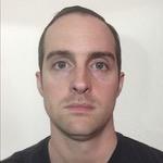 Passport photograph of Jerry banfield in a dark shirt