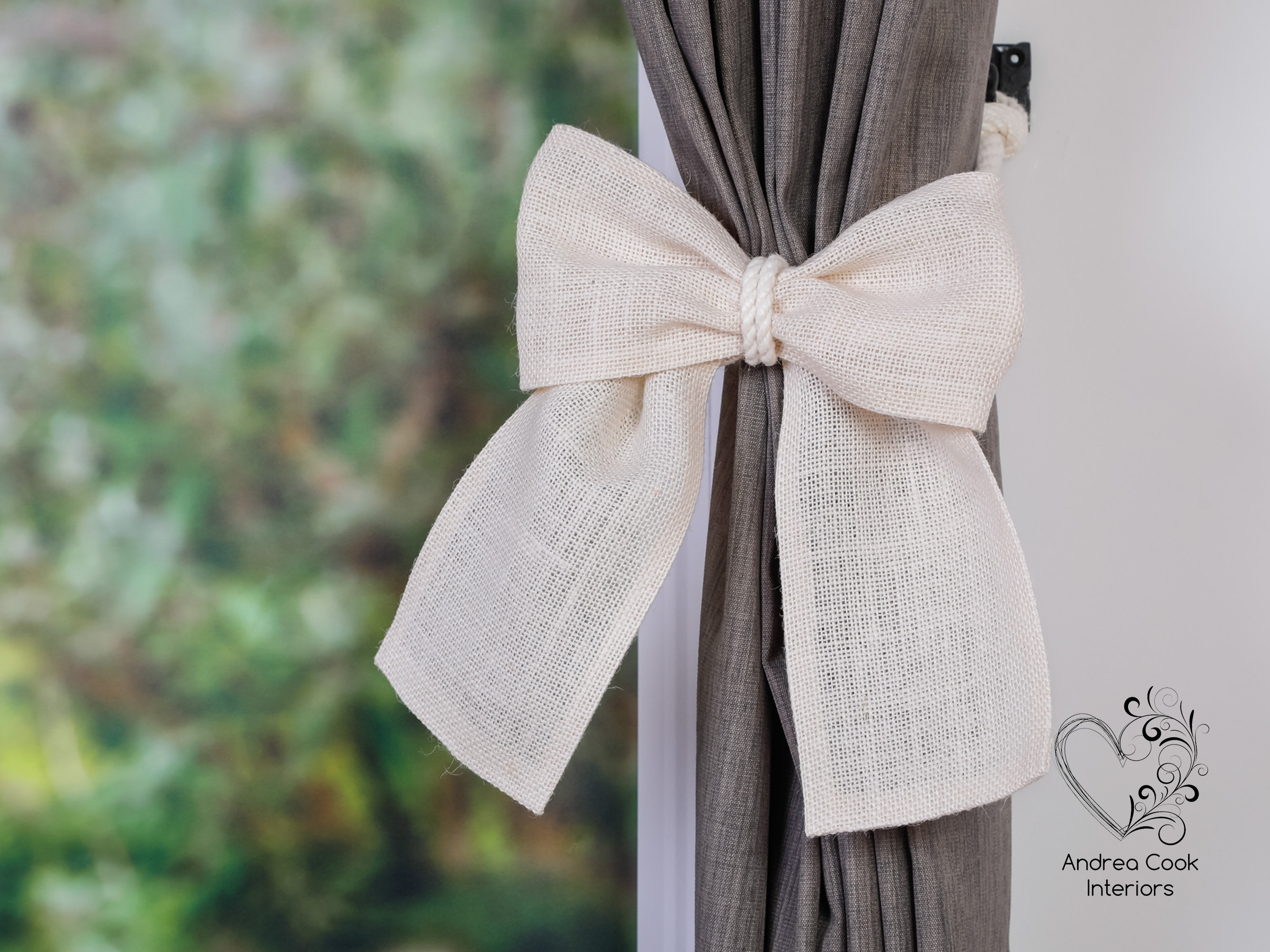 mustard yellow burlap bow on an ivory white tieback andrea cook interiors