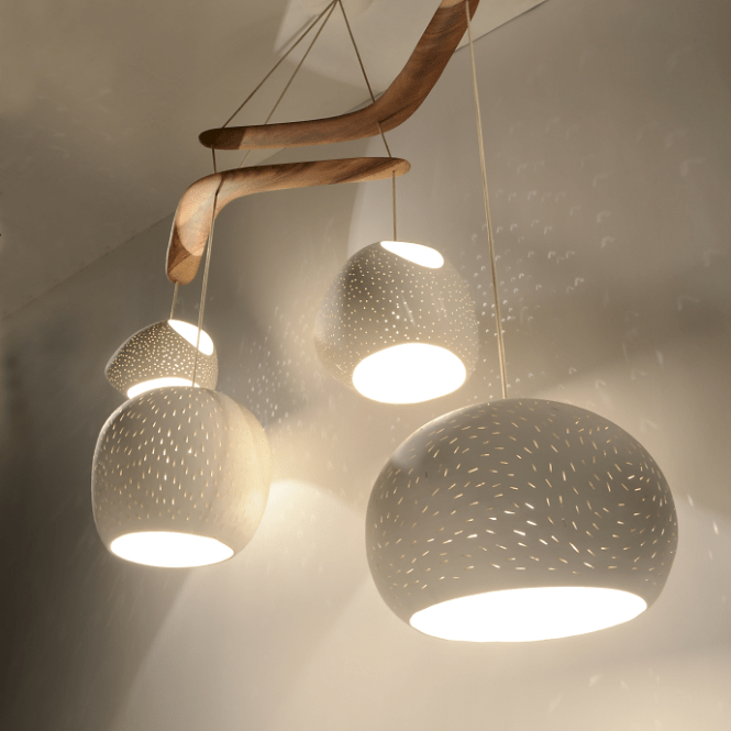 Four Large Ceramic Light Shades Hang From Two Australian Brigalow Wood Boomerangs And Create A Mobile Of Lights Textures Shapes In This Juan Miro