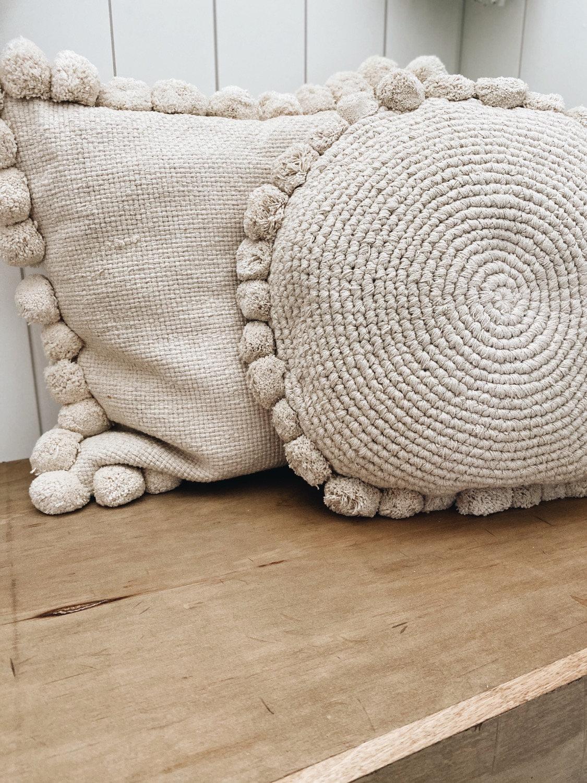 round woven pom pom pillow