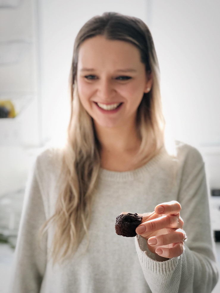 Woman holding Two-bite paleo brownies