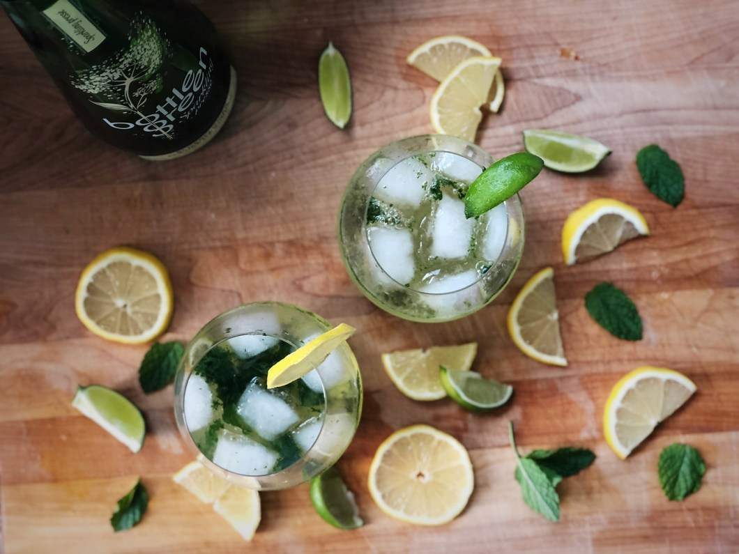 Two organic virgin mojitos with lemon, lime and mint.