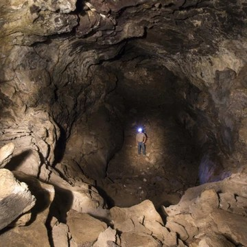cave entrance with man at the bottom