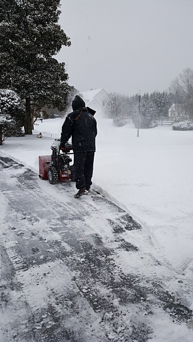 hubby using the snow blower