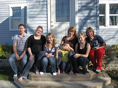 Pannell Bytes Mom and children sitting on doorstep