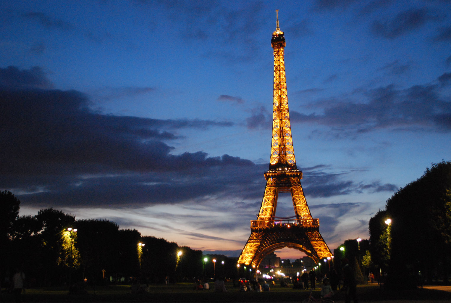 Fully lit up Eiffel Tower in Paris, France at night time