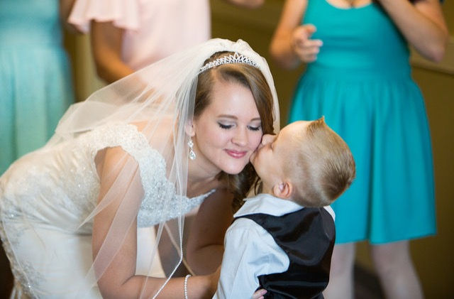 Ring Bearer kissing Bridge on Wedding Day