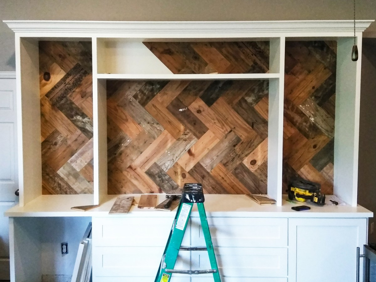 Cabinet uses rustic wood in a herringbone pattern