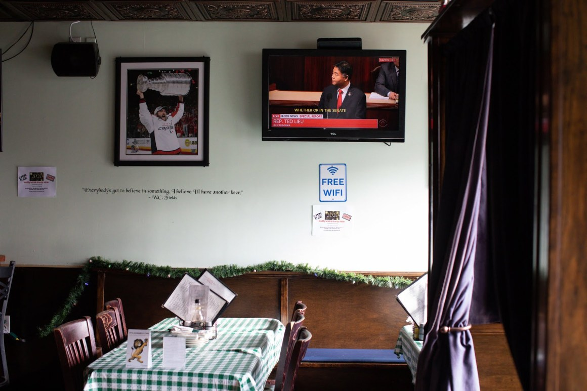 A television at Duffy's Irish Pub in Washington showed Representative Ted Lieu, Democrat of California, speaking on the House floor.