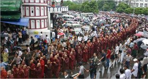Image result for 2007 –100,000 people take part in anti-government protests in Yangon, Burma