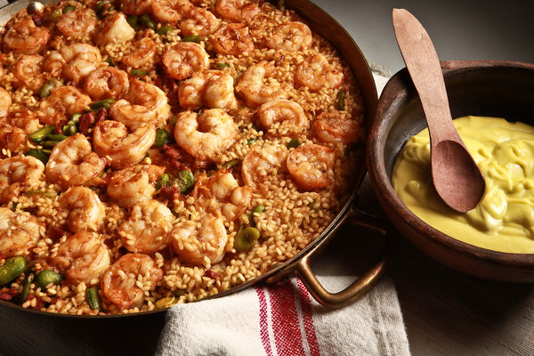 Paella with shrimp and fava beans.