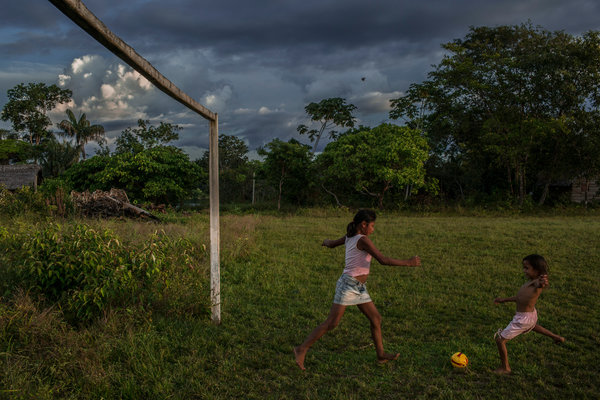 Sateré-Mawé Indians playing soccer in the Nova Belo Horizonte village.  Credit Mauricio Lima for The New York Times