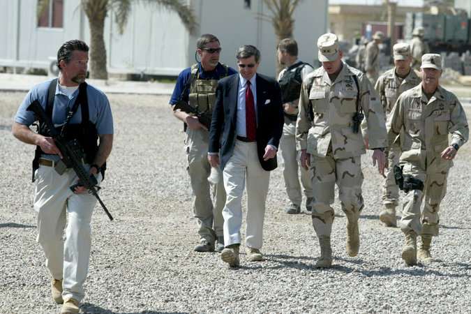 Blackwater personnel escorting Paul Bremer, an American civil administrator, upon his arrival in Ramadi, Iraq, in March 2004
