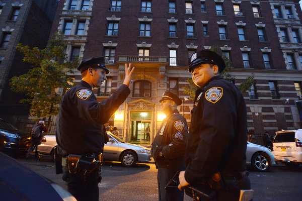Police officers stood outside the apartment of Dr. Craig Spencer on West  147th Street in Harlem on Thursday. CreditJennifer S. Altman for The New  York Times