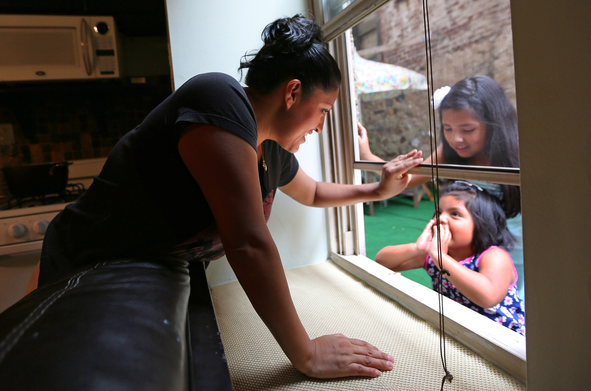 Nancy Otavalo With Her Daughter 4 At Bottom Of Window And Niece Credit Nicole Bengiveno The New York Times