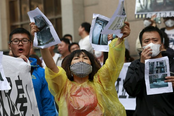 Displaced residents protested in Tianjin, China, on Wednesday to demand that the government buy back their homes. CreditKim Kyung-Hoon/Reuters