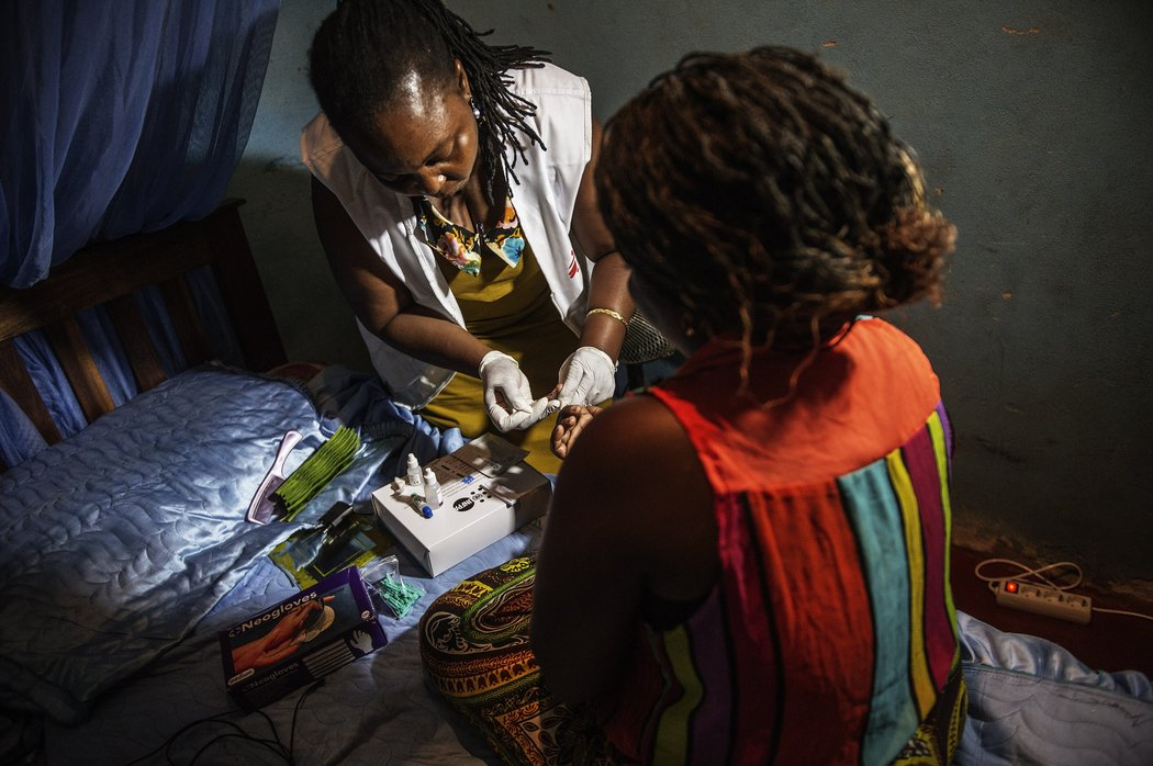 A medic with Doctors Without Borders testing a sex worker for H.I.V. in Beira, Mozambique, in October 2014. Credit Gianluigi Guercia/Agence France-Presse — Getty Images