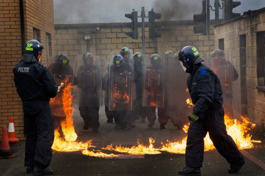 Scottish police officers simulated a riot at the Jackton training center in Glasgow, Scotland, where police leaders from throughout the United States gathered to discuss department tactics.