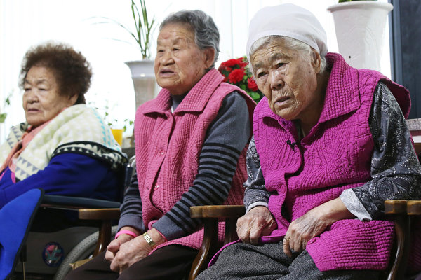 South Korean women, who said they were forced to serve as sex slaves for the Japanese Army during World War II, waiting to hear the outcome of a meeting between the foreign ministers of South Korea and Japan in Gwangju, South Korea, on Monday. Credit Yonhap, via Associated Press