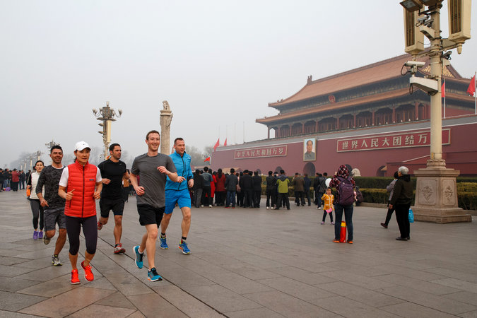Facebook co-founder and chief executive Mark Zuckerberg, front right, running past Tiananmen gate, the entrance to the Forbidden City, in Beijing, on Friday. Credit Facebook, via Agence France-Presse — Getty Images
