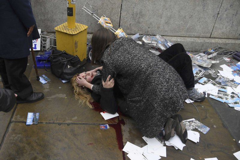 A Woman Tended To An Injured Person On Westminster Bridge On Wednesday Credit Toby Melvillereuters