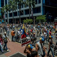 In Venezuela's Chaos, Elites Play a High-Stakes Game for Survival by AMANDA TAUB and MAX FISHER
