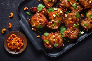 Grilled soy-basted chicken thighs with spicy cashews.
