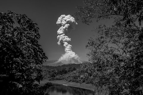 The Volcán de Colima spews ash and smoke, seen from San Antonio, Colima State.