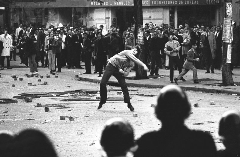 A student hurling rocks at the police in Paris during the May 1968 student uprising.
