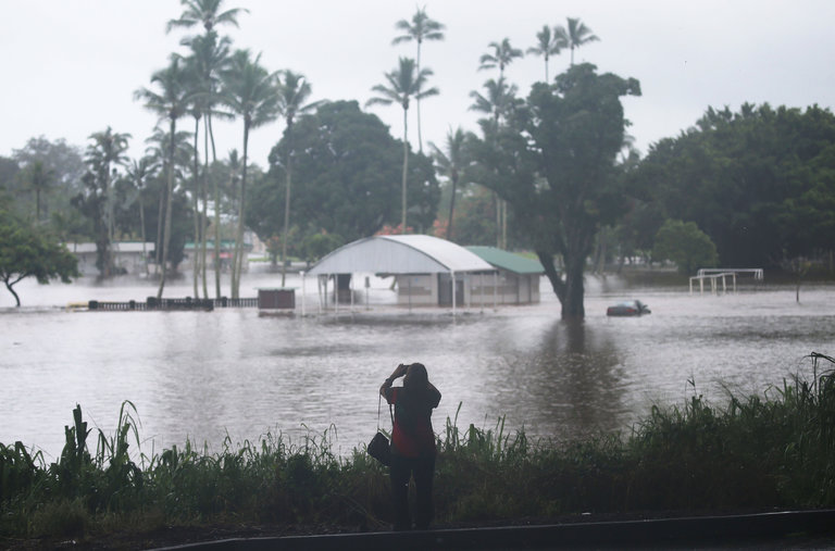 Hawaii Braces for a Rare Encounter With a Hurricane   The New York Times Flooding in Hilo  Hawaii  where the outer bands of Hurricane Lane dumped  several inches of rain on Thursday  Credit Mario Tama Getty Images